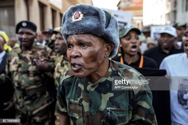 South African ruling party African National Congress and South African President Jacob Zuma supporters march to parliament in Cape Town on August 8...