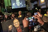 South African ruling party African National Congress members and supporters pose with a portrait of South African and ANC president Jacob Zuma during...
