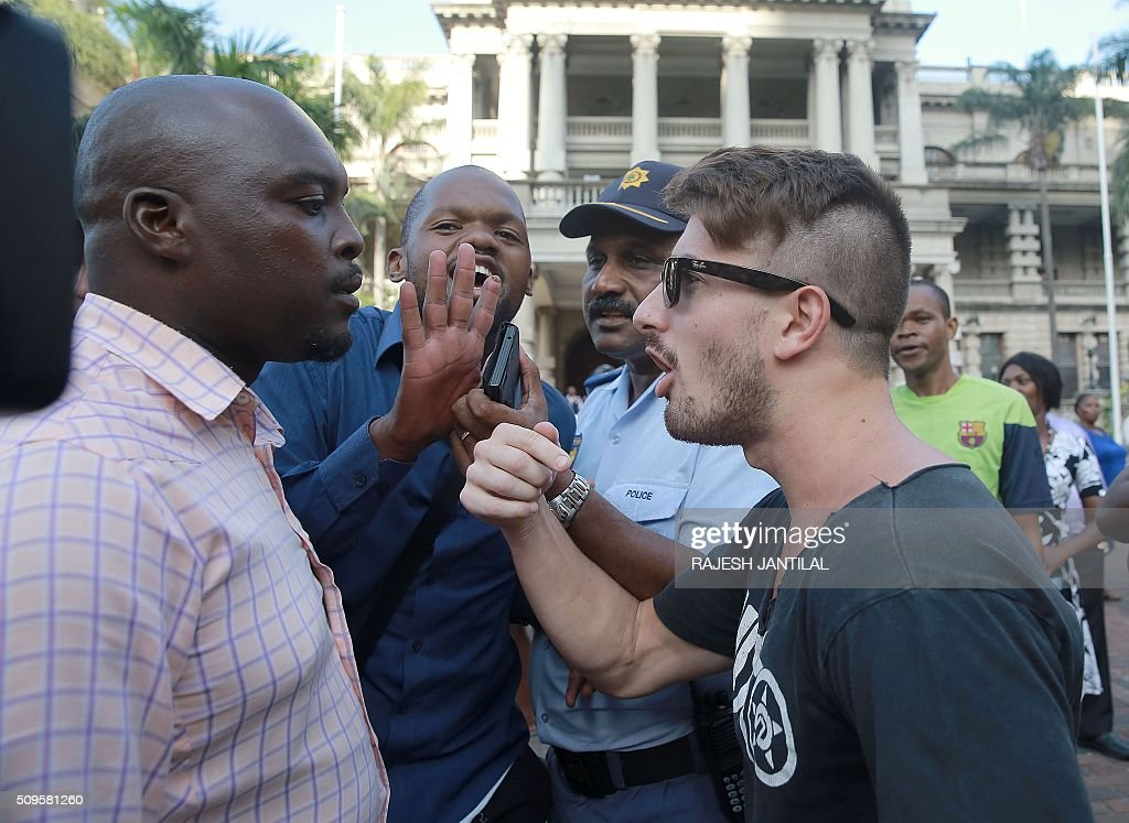 South African ruling party African National Congress President Jacob Zuma supporters argue with #ZUMAMUSTFALL supporters and campaigners demonstrating against South African president Jacob Zuma on February 11, 2016 in Durban, South Africa few hours ahead of his State of the Nation address. JANTILAL