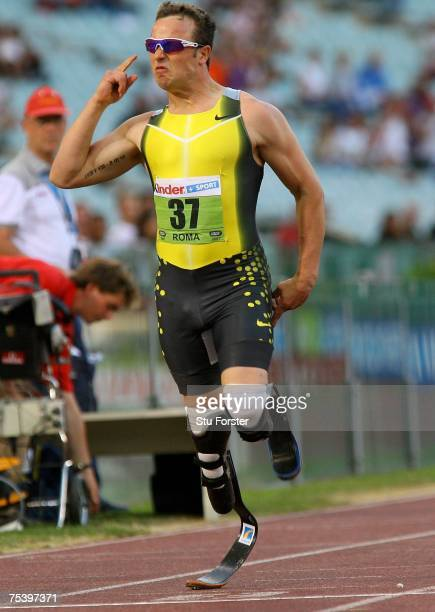 South African runner Oscar Pistorius celebrates after winning the Mens 400m 'B' race during the IAAF Golden Gala at The Olympic Stadium on July 13...