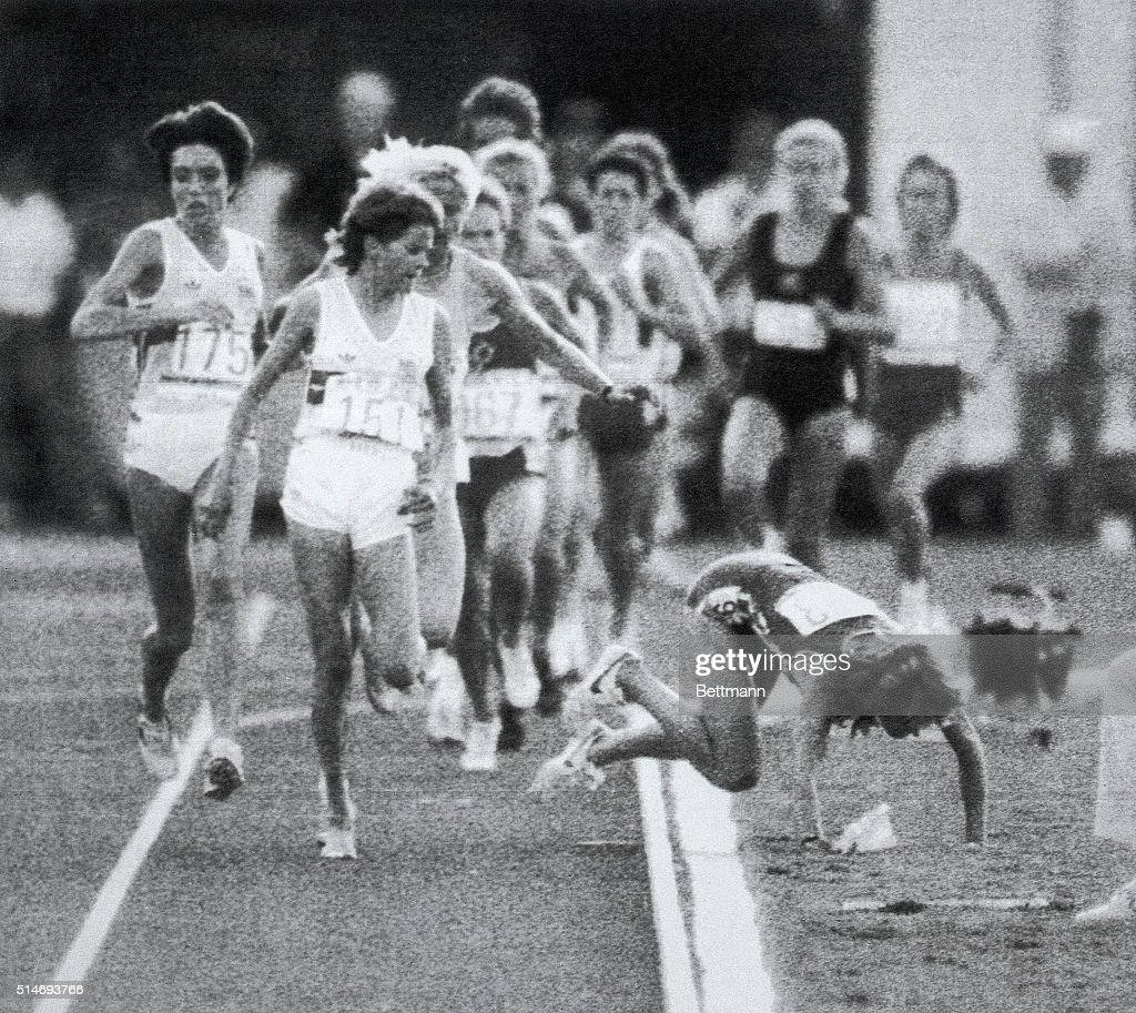 South African runner Zola Budd (front, center) watches her chief competitor, American Mary Decker, fall to the ground in the final of the women's 3000-meter run at the 1984 Summer Olympics. Decker and Budd had become entangled resulting in Decker's fall. Romanian Maricica Puca eventually won the race. Los Angeles, California, August 10, 1984.