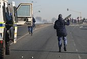 South African security forces fire tear gas during a protest prior to municipal elections in Meyerton town of Guaeteng South Africa on July 22 2016