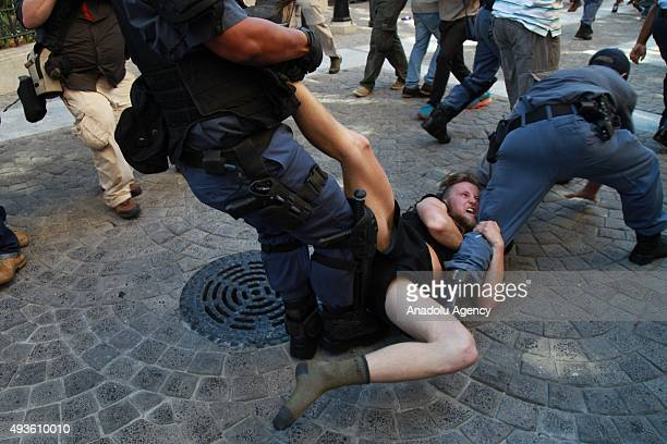 South African security forces intervene the students who march towards the Parliament building in Cape Town South Africa on October 21 2015 during a...