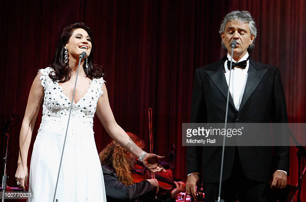 South African singer Nianell and tenor Andrea Bocelli perform on stage during the Celebrate Africa The Grand Finale at the Coca Cola Dome on July 9...