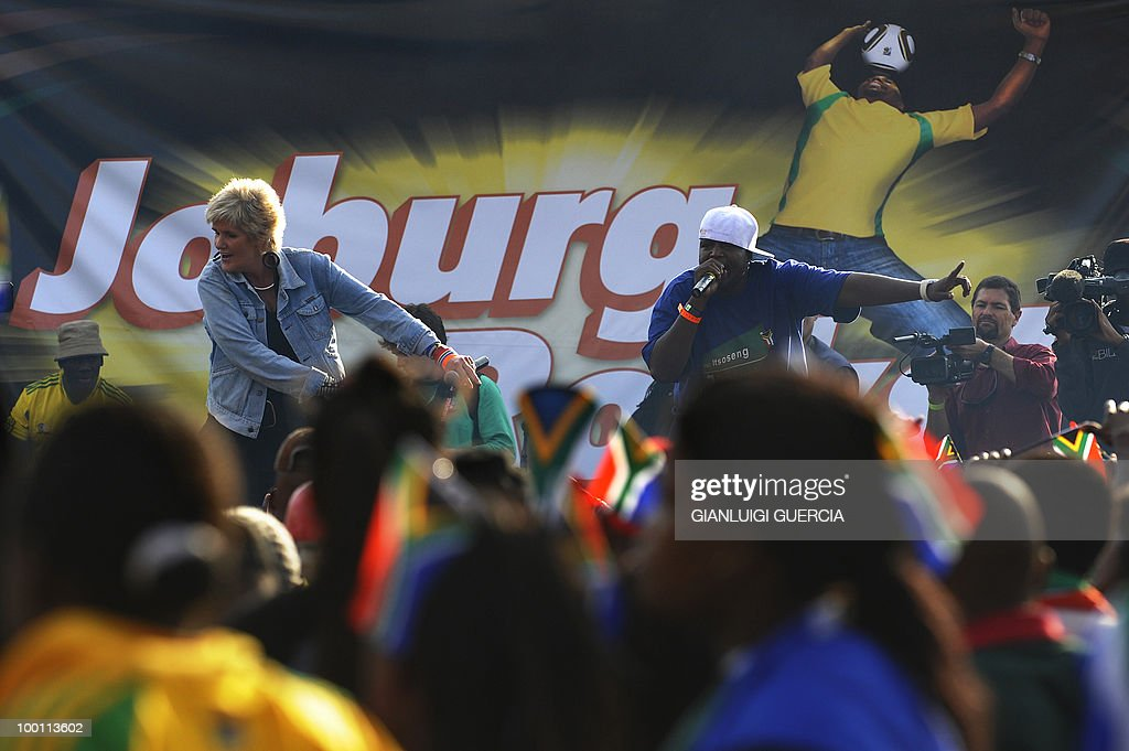 South African singer P.J. Powers and W.H.P perform on stage on May 21, 2010 during the official celebration marking 20 days ahead of the FIFA WC2010 kick off at Vilakazi street in Soweto, South Africa. South Africa will host the FIFA World Cup from the 11 of June to the 11 of July, 2010.