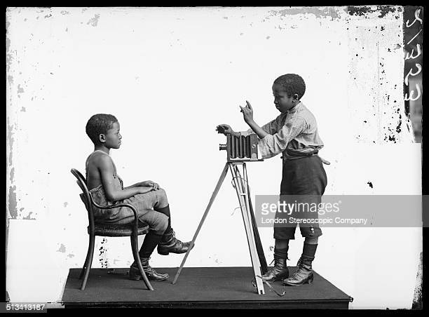 South African singers Albert Jonas and John Xiniwe of The African Choir in a staged photographic portrait session 1891 The choir drawn from seven...