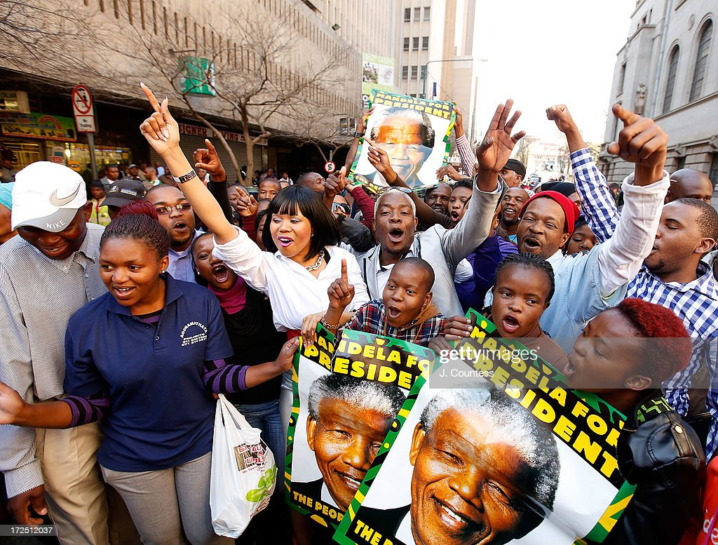 South African singers Chomme and Jamela join a crowd gathered in support of former South African President Nelson Mandela during an African National Congress-sponsered prayer rally outside ANC headquarters on July 2, 2013 in Johannesburg, South Africa. The anti-apartheid icon and Nobel Peace Prize Laurete has been in the hospital for more than three weeks being treated for a recurring lung infection.