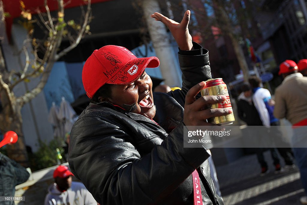 South African soccer fan Nosinto Mcimeli dances while watching a World Cup match on a large monitor at a public viewing area on June 15, 2010 in Johannesburg, South Africa. Despite freezing temperatures fans came out to watch the matches.