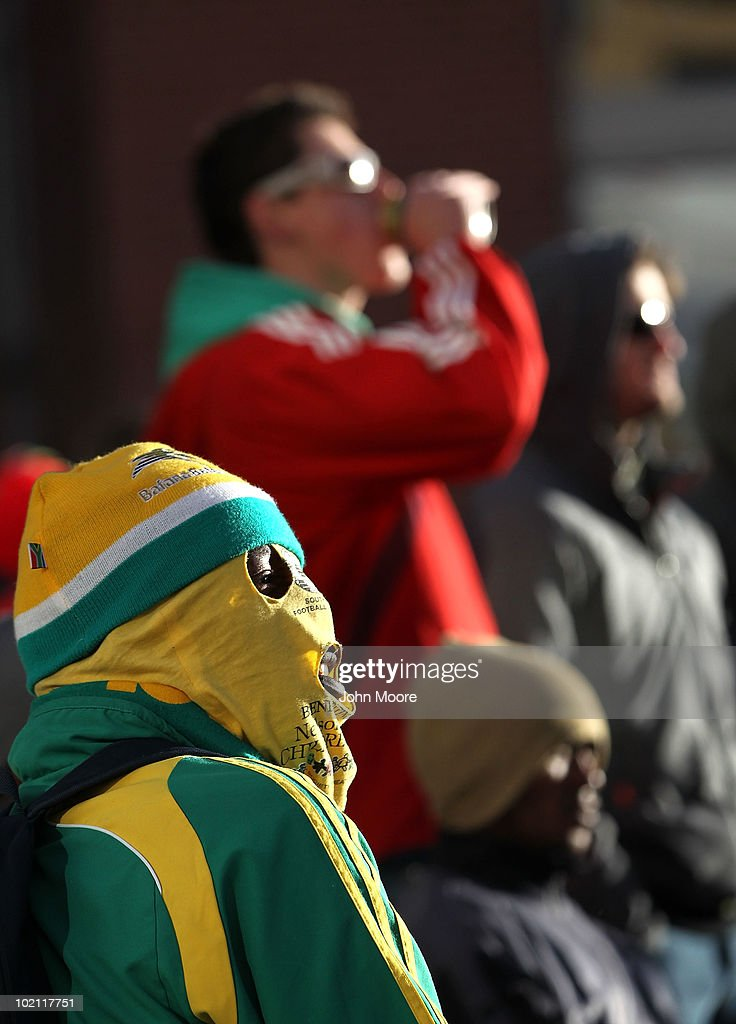 South African soccer fans bundle up while watching a World Cup match on a large monitor at a public viewing area on June 15, 2010 in Johannesburg, South Africa. Despite freezing temperatures fans came out to watch the matches.