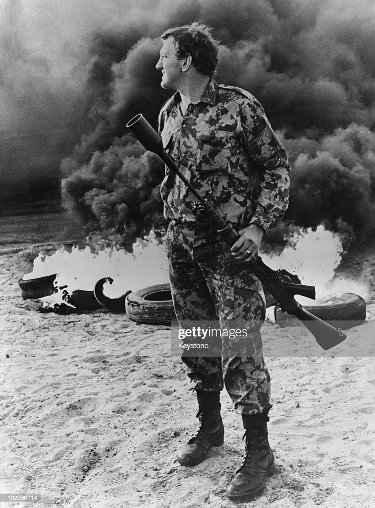 A South African soldier holding a tear gas grenade launcher during rioting near Cape Town, South Africa, 15th September 1976. The unrest comes in the wake of the Soweto uprising of the previous June.