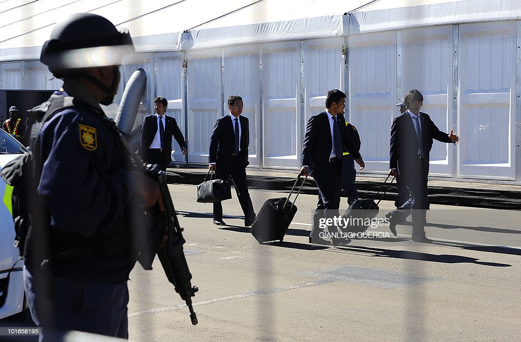 A South African special protection unit policeman stands guard at the O.R. Tambo international airport in Johannesburg as staff and players of Japan's national football team leave for their hotel on June 6, 2010 ahead of the 2010 World Cup football tournament.