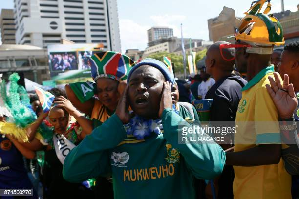 South African sporting fans react with disappointment following the announcement of the winning candidate to host the 2023 Rugby World Cup at a...