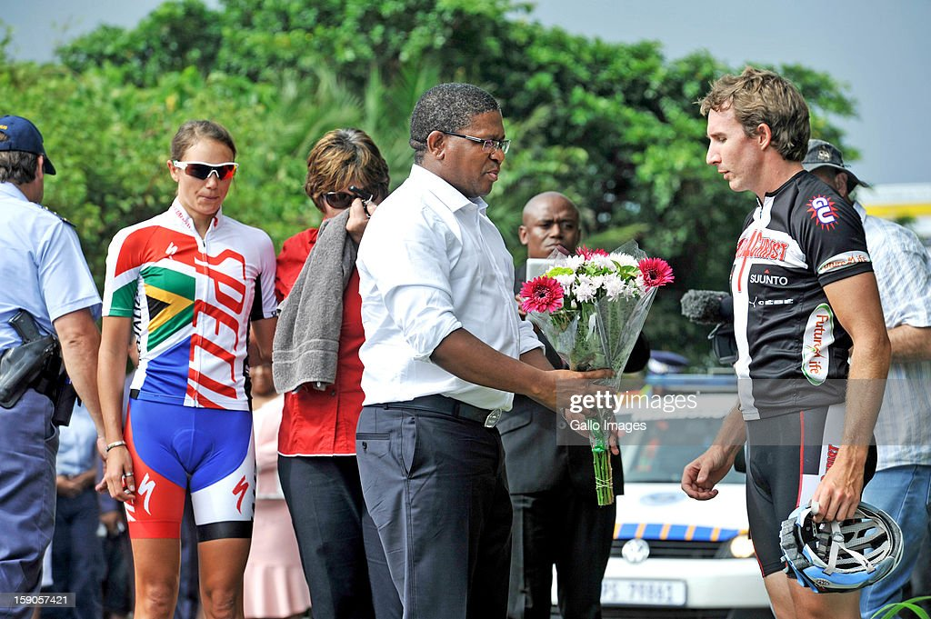 South African Sports Minister Fikile Mbalula gives Justin Borteous condolences at the sight of the accident, where Burry Stander lost his life, on January 6, 2013 in Balito, South Africa. Burry was hit by a taxi while out on a training ride, he suffered severe head trauma and a broken neck, he was killed on impact. The taxi driver has been charged with culpable homicide.