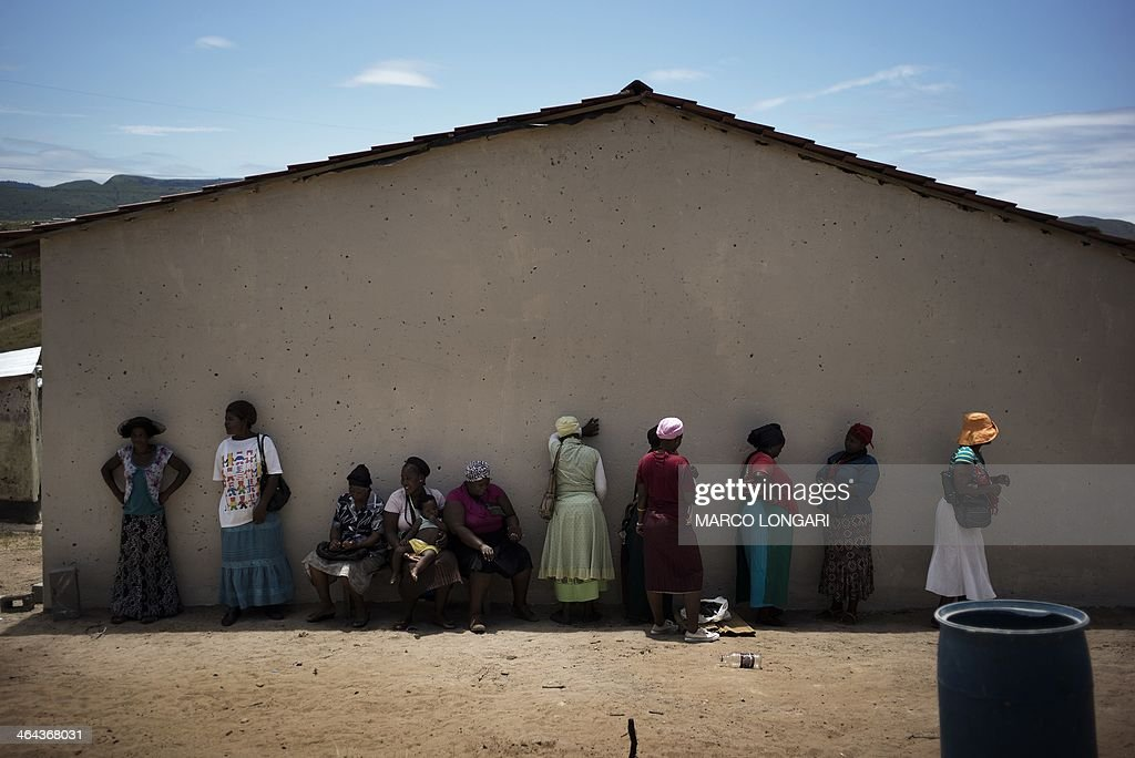 South African Sthandiwe Hlongwane stands with other women outside a newly built house she received from the Economic Freedom Fighters leader and...