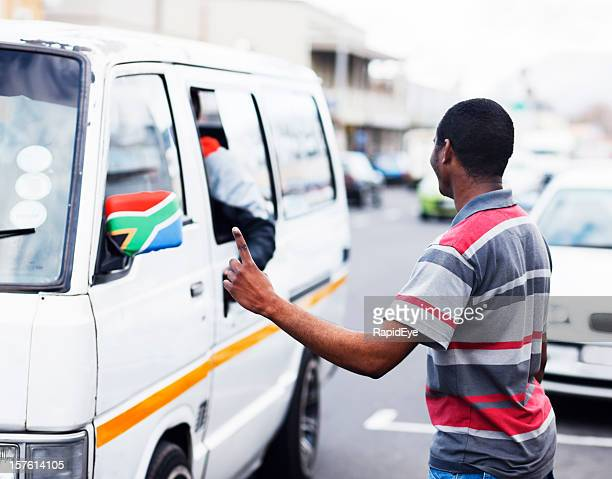 South African street scene with man signalling a taxi