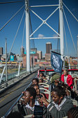South African students from Chief Albert Luthuli Primary and High School in Daveyton take a ride on a bus tour in Johannesburg on June 15 on the eve...