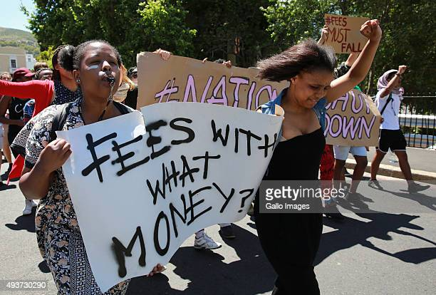 South African students protest outside the parliament precinct before forcing their way through the gates of parliament on October 21 2015 in Cape...
