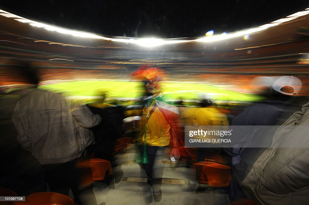 A South African supporter cheers ahead of the international friendly football match between South Africa and Colombia at the Soccer City stadium in Soweto, Johannesburg on May 27, 2010. The 2010 FIFA World Cup football championship is due to take place in South Africa from June 11 to July 11 of 2010.