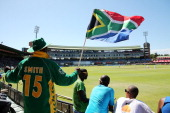 South African supporter flies his flag during day four of the Second Test match between South Africa and Australia at AXXESS St George's Cricket...