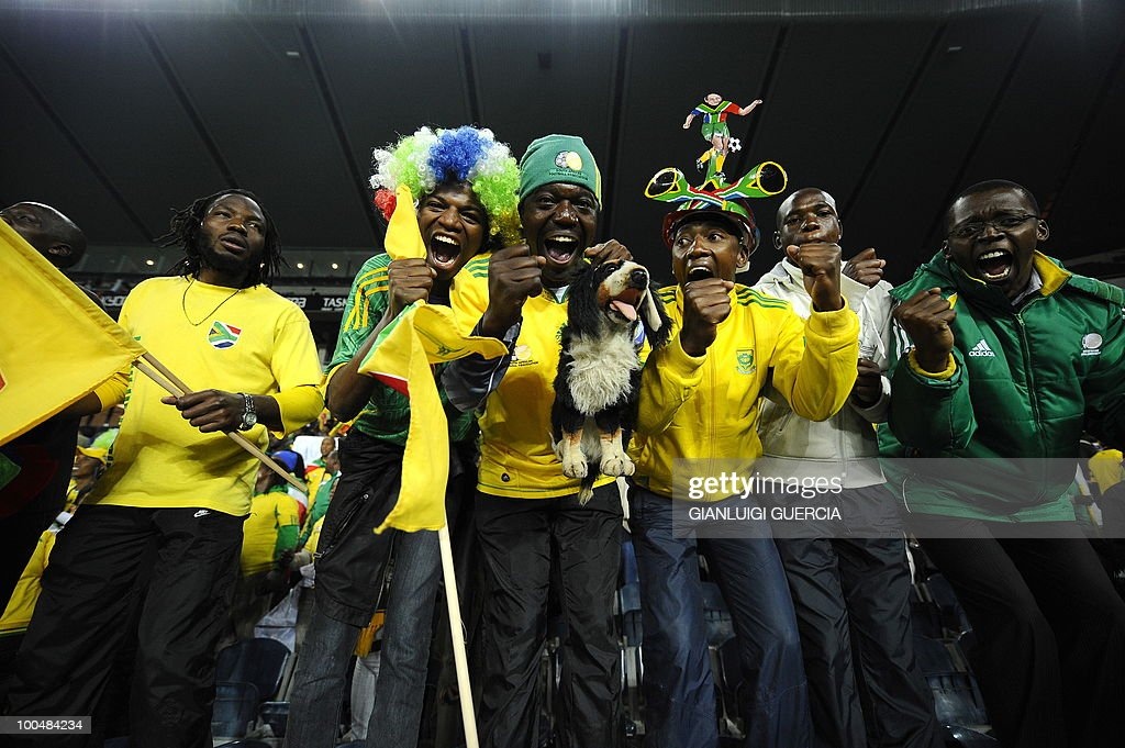 South African supporters cheer ahead of their international friendly football match against Bulgaria at the Orlando stadium in Soweto, Johannesburg. on May 24, 2010. The 2010 FIFA World Cup football championship is due to take place in South Africa from June 11 to July 11 of 2010.
