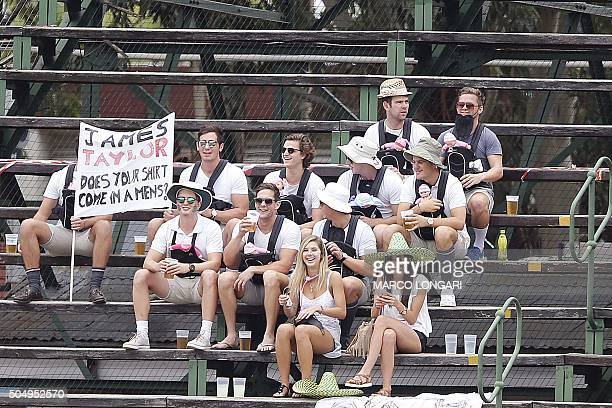 South African supporters hold a banner making fun of England player James Taylor during the firts day's play in the third Test cricket match between...