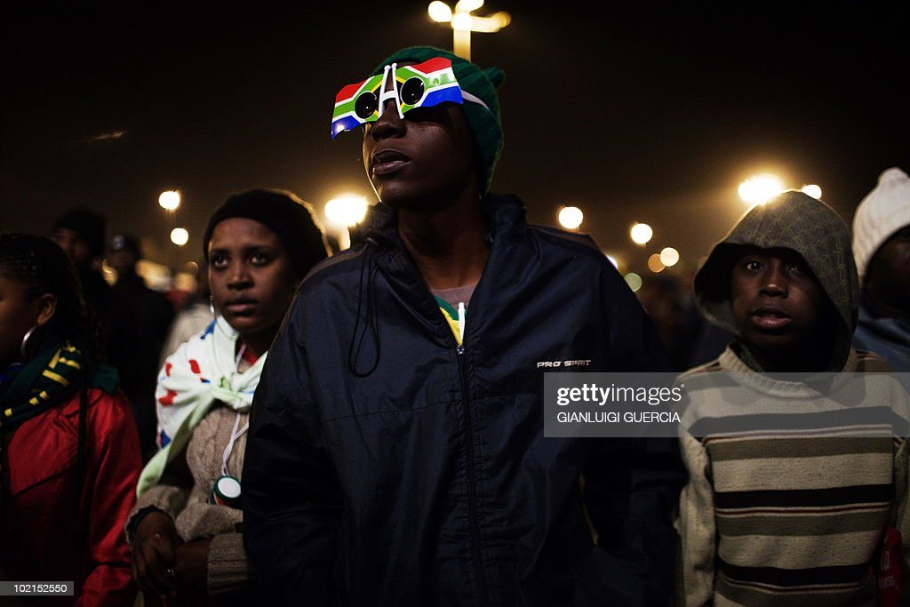 South African supporters watch the Group A first round 2010 World Cup football match between South Africa and Uruguay at the FIFA Fan fest park on June 16, 2010 in Soweto, Johannesburg. Uruguay, the two-time world champions beat host nation South Africa 3-0.