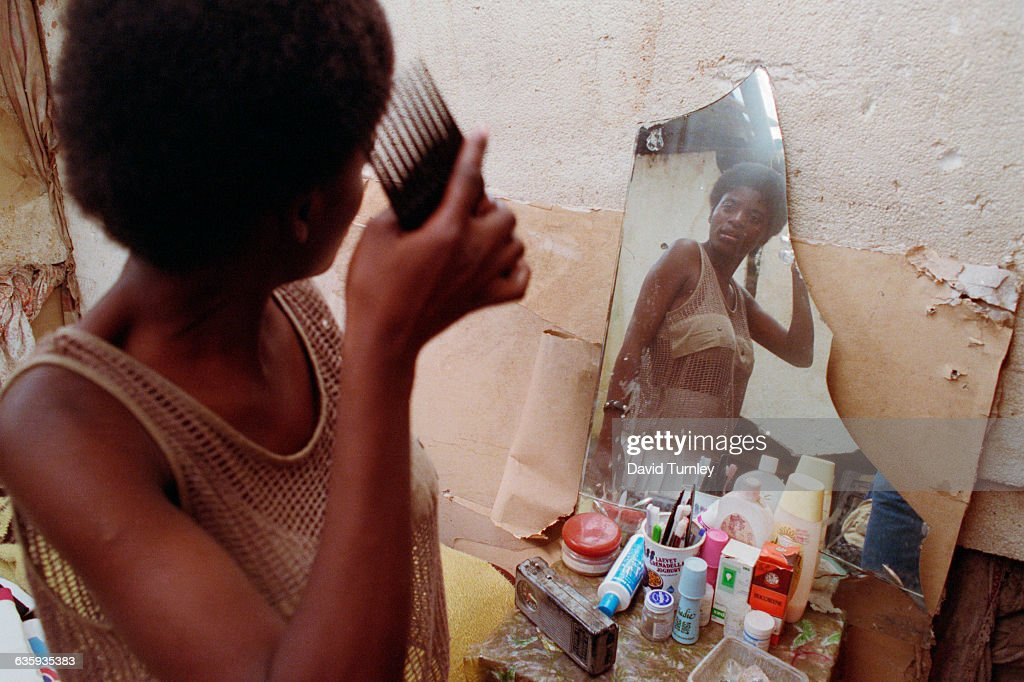 South African Teenager Combing Her Hair