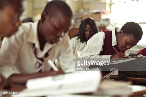 South African teenagers concentrating on an English exam