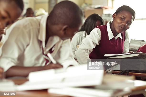 South African teenagers flirting in class