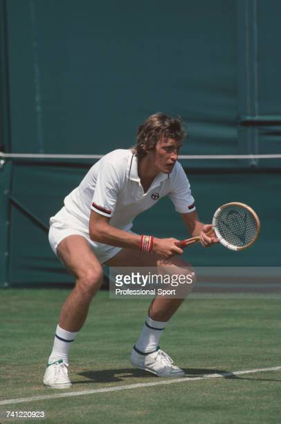 South African tennis player Cliff Drysdale pictured in action against American tennis player John Austin in the first round of the Men's Singles...