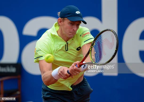 South African tennis player Kevin Anderson returns the ball to Spanish tennis player Rafael Nadal during the ATP Barcelona Open 'Conde de Godo'...