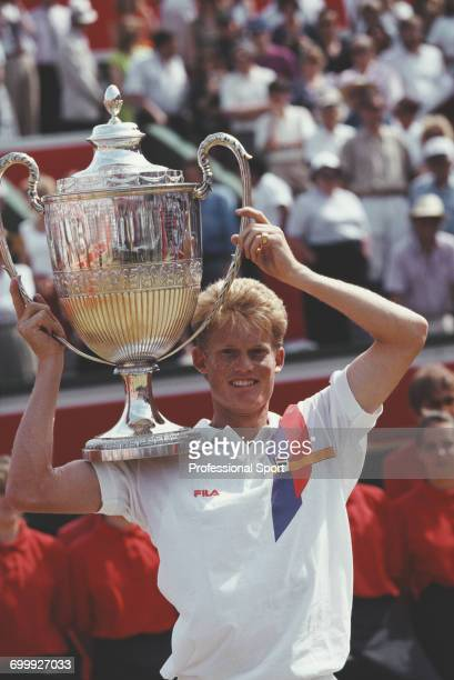 South African tennis player Wayne Ferreira holds up the trophy after defeating Japanese tennis player Shuzo Matsuoka 63 64 to win the final of the...