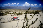 South African Toyota driver Giniel De Villiers and codriver Dirk Von Zitzewitz compete during the Stage 5 of the Dakar 2014 between Chilecito and...