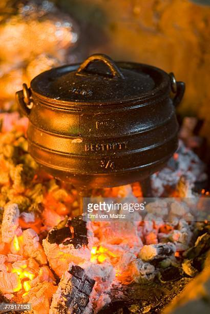South African Traditional Cooking Pot (Potjie Pot) Standing in the Embers of a Fire. Fort Fordyce, Eastern Cape Province, South Africa