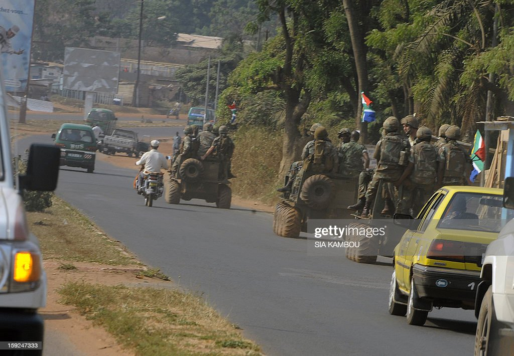 South African troops patrol on January 10, 2013 a position in Bangui. Three-way peace talks between the Central African government, the rebel coalition that conquered much of the country over the past month and the political opposition began on January 9 in Gabon. With a lightning advance starting December 10, the rebels took over most of the Central African Republic. They are demanding that Central African President Francois Bozize step down, but the head of state, who took power in a 2003 coup, warned on the eve of the talks that he would not leave his job.