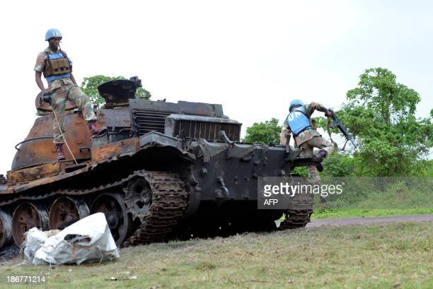 South African UN troops check out a burnt out tank abandoned by M23 rebels on November 3 2013 in KibumbaDemocratic Republic of Congo's army on Monday...