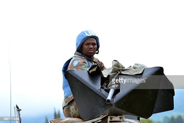 South African UN troops patrol on November 3 2013 in KibumbaDemocratic Republic of Congo's army on Monday pounded the remaining hilltop positions of...