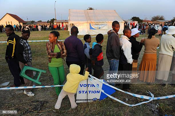 South African voters in Tokoza township line up in the east of Johannesburg on April 22 2009 to cast their votes in the country's fourth election...