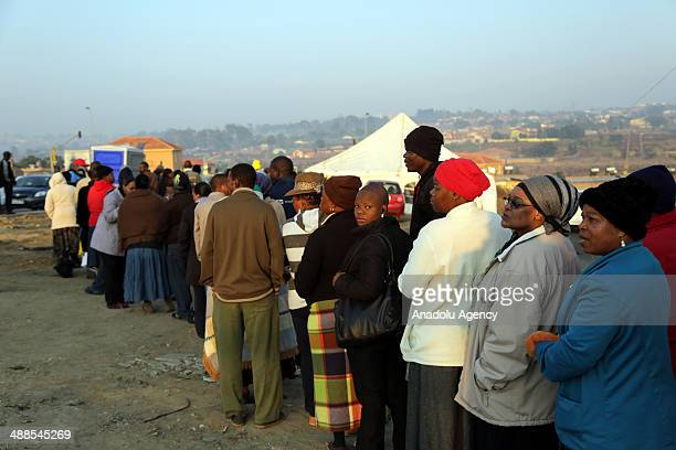 South African wait in queue to cast their ballots in the 2014 South African general election in Alexandra township near Johannesburg South Africa on...