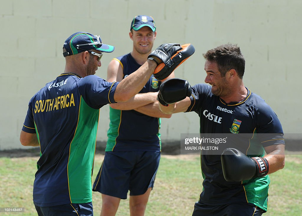 South African wicketkeeper Mark Boucher (R) boxes with trainer Robert Walter (L) during a training session before the second test at the Warner Park ground in the St Kitts capital of Basseterre on June 16, 2010. South Africa have taken a 1-0 lead in the three-Test series, with the second test beginning on June 18. AFP PHOTO/Mark RALSTON