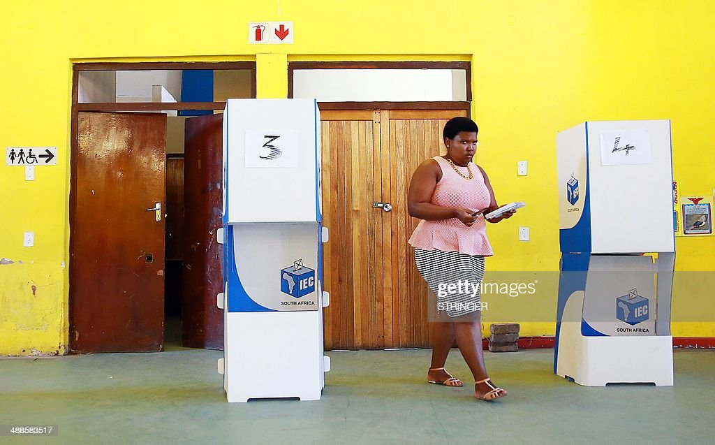 A South African woman walks towards a ballot box to vote at the Sivananda FET College in Kwa-Mashu, some 35 kms north of Durban, on May 7, 2014 as South Africa held its fifth post-apartheid general elections. Twenty years after South Africans of all colours wowed the world by voting to end apartheid, they shrugged off sporadic violence and flocked to the polls for another landmark election. AFP PHOTO/RAJESH JANTILAL