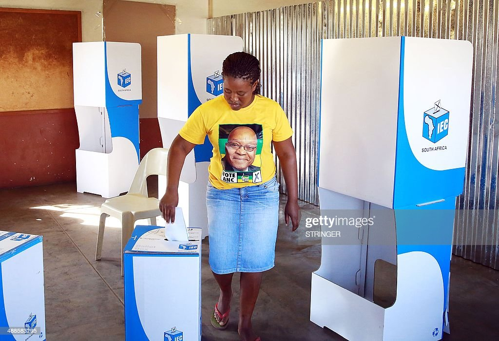 A South African woman wearing a t-shirt with the picture of President Jacob Zuma casts her ballot at the Baqaqe Primary School in Eshowe, some 150 kms north of Durban, on May 7, 2014 as South Africa held its fifth post-apartheid general elections. Twenty years after South Africans of all colours wowed the world by voting to end apartheid, they shrugged off sporadic violence and flocked to the polls for another landmark election.