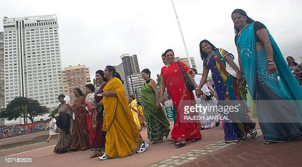 South African women from all races and creeds dressed in traditional Indian Sari clothes participate in the 'Sari Pride' march in Durban on November...