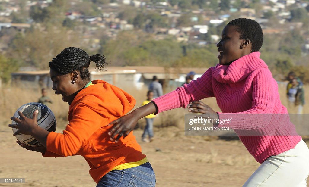 South African youths play with a ball at a makeshift football field outside the Atteridgeville township near Pretoria on June 16, 2010 as the 2010 World Cup is being held in South Africa.
