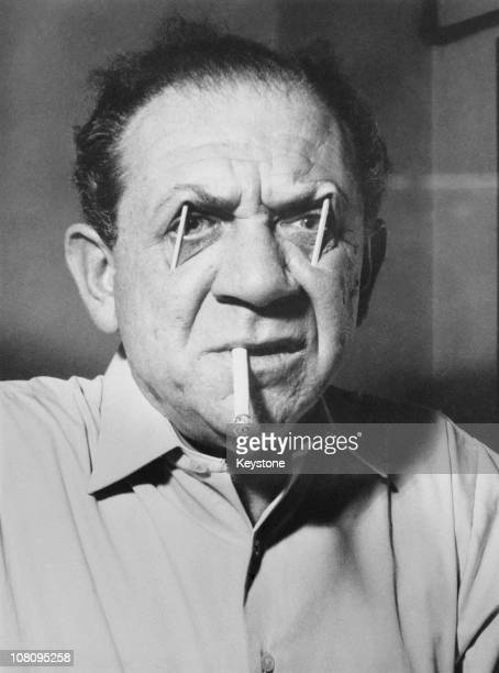 South Africanborn actor Sid James uses matchsticks to prop up his eyebrows 23rd December 1959