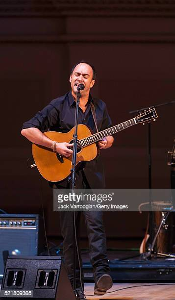 South Africanborn American musician Dave Matthews plays guitar as he performs onstage at the 'Twenty Years of Freedom' concert during the 'Ubuntu...