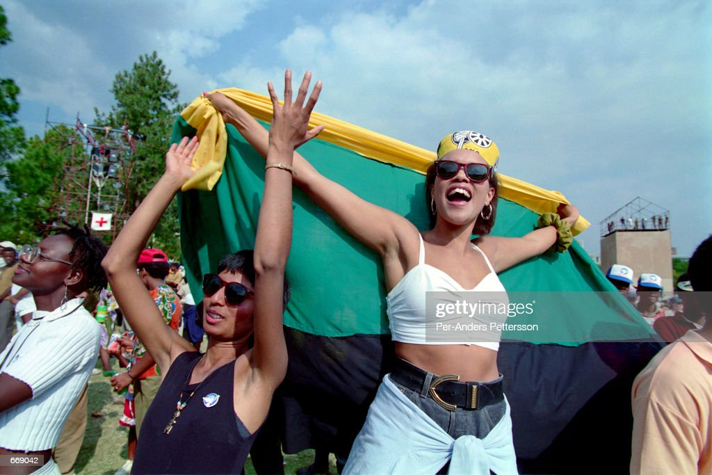 South Africans celebrate the inaguration of President Nelson Mandela June 10, 1994 in Pretoris, South Africa. The first historic democratic election was held April 27, 1994 and President Nelson Mandela was elected for one 5-year term.