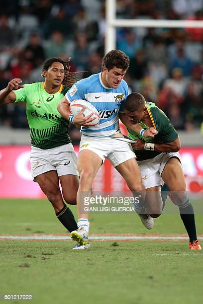 South African's Rayno Benjamin tackles Argentina's Joaquin Riera during the Rugby Sevens series Cape Town leg Cup final against Argentina on December...