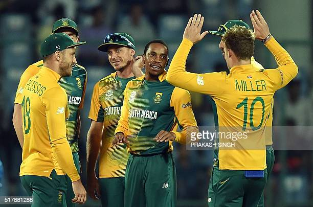 South Africa's Aaron Phangiscelebrates the wicket of Sri Lanka's batsman Lahiru Thirimanne with teammate David Milleras captain Faf du Plessislooks...