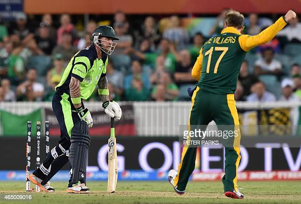 South Africa's AB de Villiers celebrates after bowling Ireland's John Mooney during the 2015 Cricket World Cup Pool B match between Ireland and South...